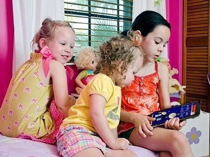 Children reading BookLingual Spanish for children dual-language storybooks.