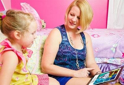 Amanda and Audrey reading BookLingual Spanish for children dual-language storybooks.